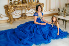Beautiful princess mother and daughter in a gold crown Stock Image