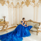 Beautiful princess mother and daughter in a gold crown Stock Photography