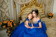 Beautiful princess mother and daughter in a gold crown Royalty Free Stock Photography