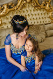 Beautiful princess mother and daughter in a gold crown Royalty Free Stock Images