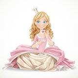 Beautiful princess in a pink dress sitting on the floor Royalty Free Stock Photos