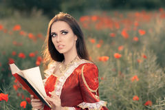 Beautiful Princess Reading a Book in Summer Floral Landscape Stock Images