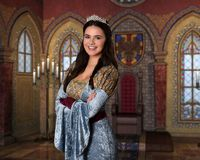 Beautiful princess in royal chamber wearing her diamond tiara stock photos