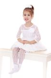 Beautiful princess sitting on white banquettes Royalty Free Stock Images