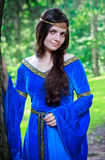 Beautiful princess standing near big tree Stock Photography