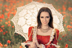 Beautiful Princess with Umbrella in Summer Floral Landscape Stock Photography