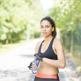Beautiful professional athlete woman with water bottle after exe Stock Image
