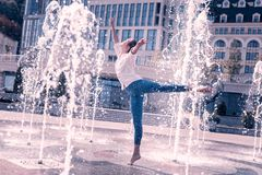 Beautiful professional ballerina dancing with bare feet. Feel everything. Beautiful professional ballerina dancing with bare feet while standing in the fountain royalty free stock images