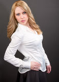 Beautiful Professional Blonde Woman in White Shirt and Skirt Royalty Free Stock Photos