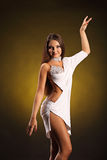 Beautiful professional dancer performs latino dance. Passion and expression. Royalty Free Stock Image
