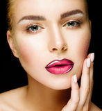 Beautiful Professional Makeup. Pink Lips and Smoky Eyes Make up. Beautiful young model with bright make-up and manicure. Professional Makeup. Pink Lips and royalty free stock image