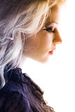 Beautiful profile blond girl thinking Stock Photography