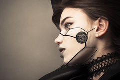 Beautiful profile face cyberpunk girl with fashion makeup. Isolated on gray background Royalty Free Stock Images