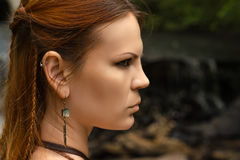 Beautiful profile face woman with braid hair. Closeup Royalty Free Stock Photography