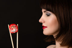 Beautiful profile face woman with chopsticks and roll Royalty Free Stock Photo