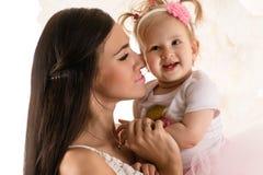 Beautiful profile face woman with daughter Stock Photos