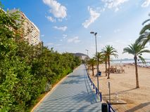 Beautiful promenade along the sandy beach and the sea in Alicante. Spain. stock photos
