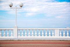 Beautiful promenade with parapet overlooking the blue sky with clouds stock photos