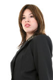 Beautiful Proud Young Hispanic Business Woman. Portrait of a beautiful proud young Hispanic business woman in suit.  Shot in studio over white Stock Photos