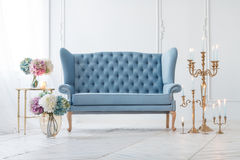 Beautiful Provance Living Room. With Blue Sofa Near Table With Flowers And Candles Royalty Free Stock Photos