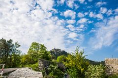 Forte Sperone and a bright blue sky. Beautiful puffy white clouds on a blue clear sky. Perfect summer weather in Genoa. This is a scene from Forte Sperone a stock image