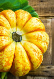 Beautiful pumpkin closeup on wooden table Royalty Free Stock Image