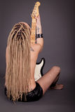 Beautiful punk girl with lots of tattoos posing with guitar Royalty Free Stock Image