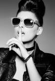 Beautiful punk woman model wearing sun glasses and leather jacket stock photos