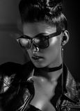 Beautiful punk woman model wearing sun glasses and leather jacket Royalty Free Stock Photos