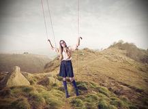 Beautiful puppet woman. Young beautiful woman in the mountains being a puppet Royalty Free Stock Photography