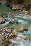 Beautiful pure green turquoise tolminka river flowing with rocks in julian alps Royalty Free Stock Images
