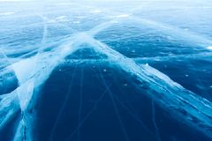 Beautiful pure ice with cracks on the Lake Baikal. Royalty Free Stock Image