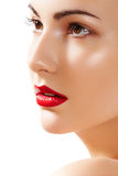 Beautiful pure model face with bright lips make-up. Close-up portrait of caucasian young woman model with glamour red lips make-up, purity complexion. Perfect royalty free stock images