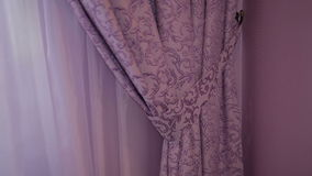 Beautiful purple curtains in the interior stock footage