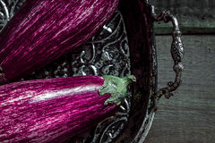 Beautiful Purple Eggplants on Dark Wooden Background Royalty Free Stock Images
