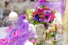 Beautiful purple flowers as a table decoration Royalty Free Stock Image