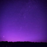Beautiful purple night sky with many stars Royalty Free Stock Photography