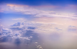 Beautiful purple sky with clouds during sunrise. View from the airplane window Royalty Free Stock Image