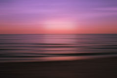 Beautiful purple sunset Burning Skies over the sea Royalty Free Stock Images