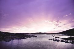 Beautiful purple sunset over the port Stock Photos