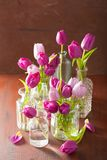 Beautiful purple tulip flowers bouquet in vase Royalty Free Stock Images