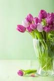 Beautiful purple tulip flowers in vase Stock Photo