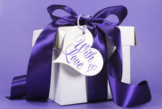 Beautiful purple and white gift with luxury ribbon stock image