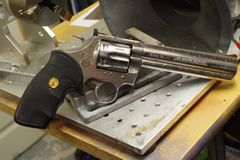 Colt Python 357 on a work bench ready for engraving. Beautiful Python 357 on a work bench for personal engraving royalty free stock photos