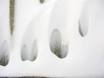 Beautiful quaint snowdrifts on a slate wave fence Royalty Free Stock Photos