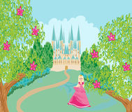 Beautiful queen in front of her castle Royalty Free Stock Images