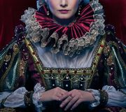 Beautiful queen. Queen in royal dress and luxuriant collar Royalty Free Stock Photography