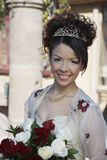 Beautiful Quinceanera Holding Flowers Royalty Free Stock Photography
