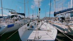 Beautiful racing sailboat docked in marina stock video footage