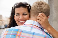 Beautiful radiant woman hugging her boyfriend Royalty Free Stock Images